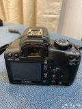كاميرا كانون دي 1000