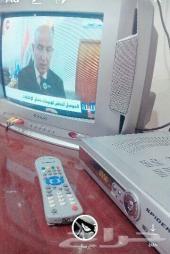 تلفزيون  ورسيفر وطاولة