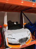 سيارة أطفال سبورت  شحن بطاريه  كهربا
