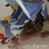 عربة اطفال توأم