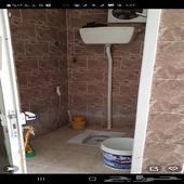 غرفة صغيرة مع حمام ومطبخ الباحة الشارع العام