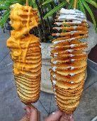 قطاعة بطاطس على شكل حلزوني