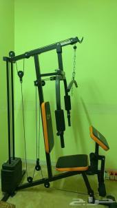 جهاز تمرين عضلات وعجلة