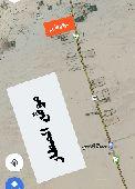 ارض قريبة من مطار القنفذة على الشارع العام