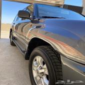 لاندكروزر 2004 GXRبريمي وكاله بدي ومحركات ف ل كامل رصاصي