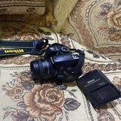 كاميره نايكون d3100 معها عدسة 50 ملي