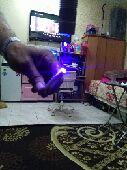 كاميرا مع ليزر ازرق حارق
