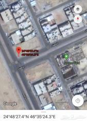 ارض تجارية حي الملقا شارعين 36 - 36