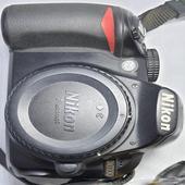 كاميرا نيكون D3100 وعدسة تامرون 70_300