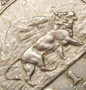 عملة مميزة عليها صورة أسد افريقي