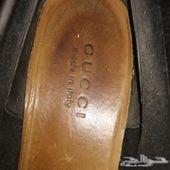 حذاء قوتشي وساعة سويسرية