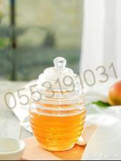 حافظة عسل على شكل جرة مع ملعقة بشكل أنيق جدا