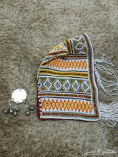 قبع نسائي وقلاده