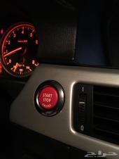 زر التشغيل باللون الأحمر بي ام دبليو BMW