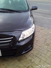 سيارة كورلا موديل 2010  اللون اسود فل كامل