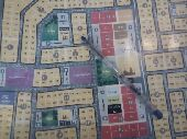 للبيع نصف أرض بمخطط الرمال مساحة 472.50م مباش