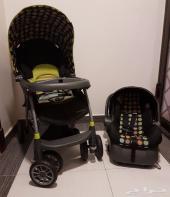 للبيع كرسي اطفال سيارة مع عربية ماركة evenflo
