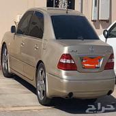 لكزز 2006 سعودي فل الفل ذهبي داخل اسود