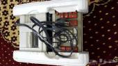 الة حاسبة قديمة يبانية تعمل على الكهرباء .