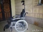 كرسي مشبوك بجهاز وقوف للمعاقين