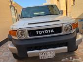 تويوتا FJ أبيض م 2013 بودي وكالة للبيع