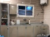 دولاب مطبخ برخام صناعي