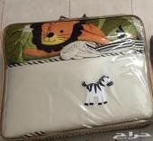 عربية اطفال و اغطية سرير