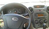 سياره للبيع كيا كارينز نظيف جدا