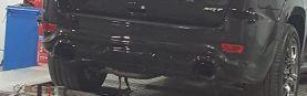 للبيع باب شنطة وشبك أمامي وصدام خلفي جيب SRT 2015