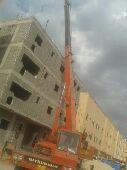 كرين  لرفع البيوت الجاهزه فوق أسطح المنازل